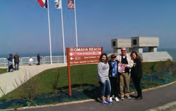 Gene and Jeanie Helton with granddaughters Tori and Sophia Hanna took Monthly to Omaha Beach in Normandy, France. The photo was taken by Melissa Hanna.