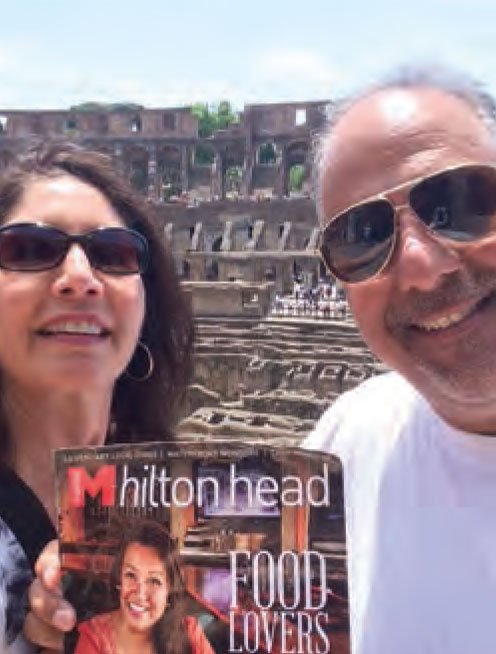 Lorraine and Bob Chillemi, touring Italy with Monthly, in front of the Roman Colosseum.