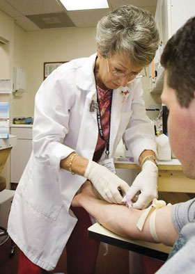 Lab technician Marge Garner volunteers her time at VIM's lab every week.