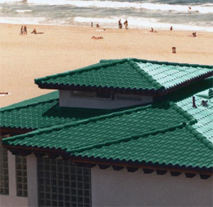 "Met-Tile produces ""tile panel"" metal shingles which resist rain, wind, rot, termites and fire."