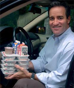 Realtor Sean Ryan brings food to those in need as a Meals on Wheels volunteer